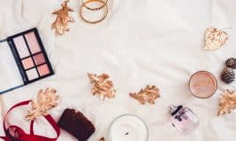 Fall beauty products from above on white